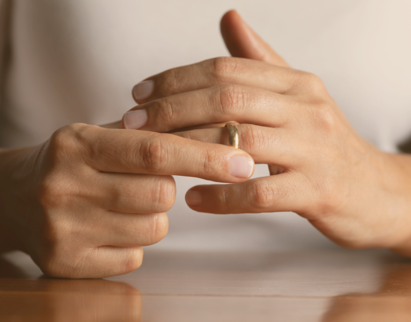 woman removing or putting on a wedding ring