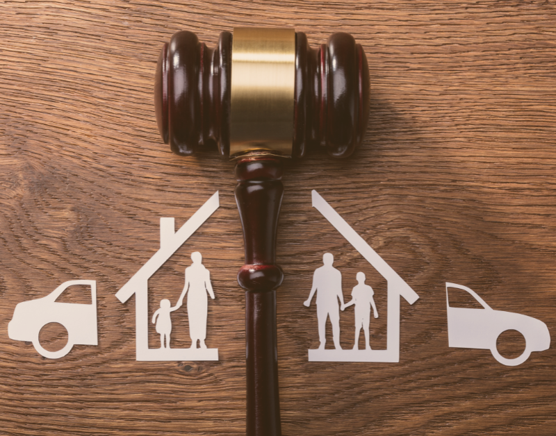 gavel with house car and family split down the middle