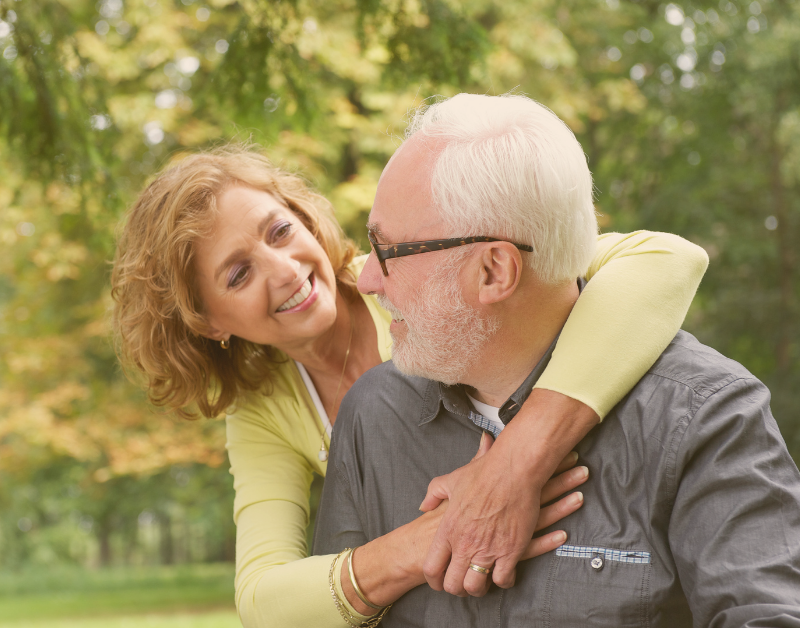 older couple outside hugging and happy