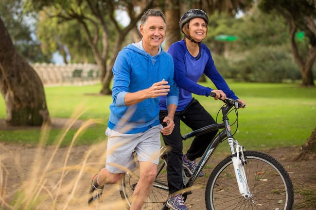 couple jogging and biking