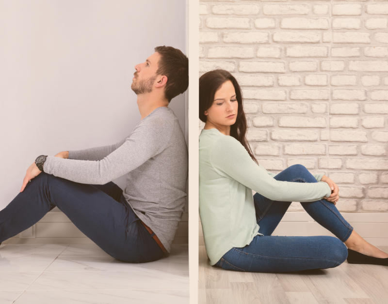 man and woman sitting against a wall on opposite sides